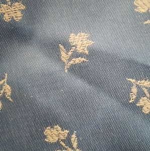 Blue embroidered floral upholstery fabric backed